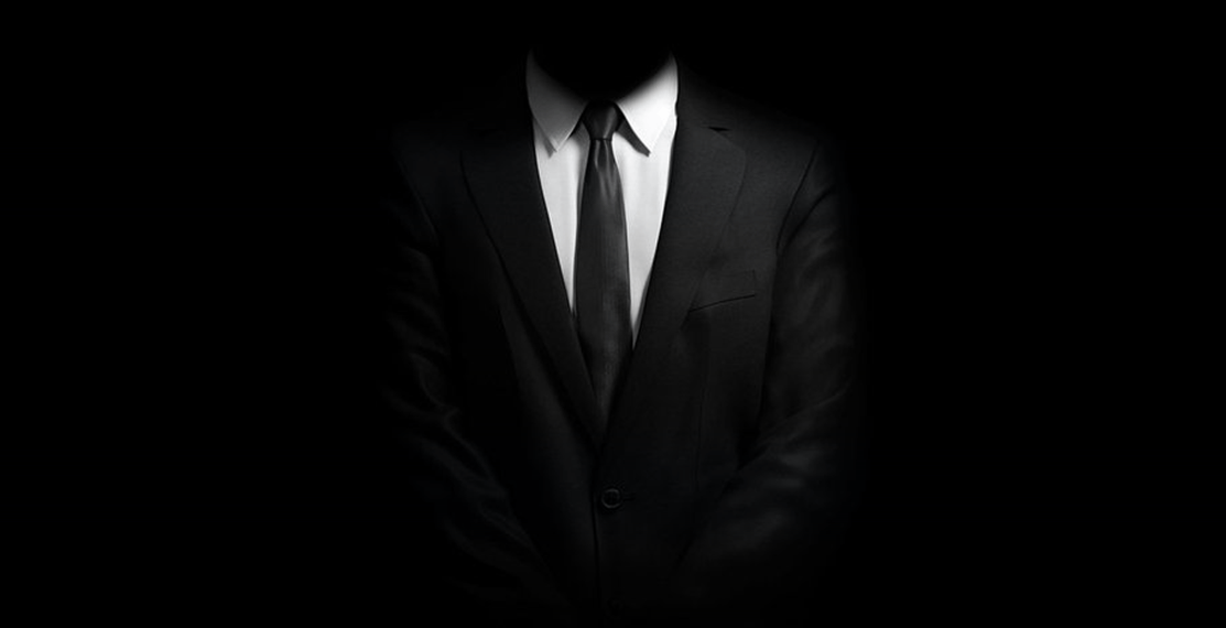 black image with a men in suit